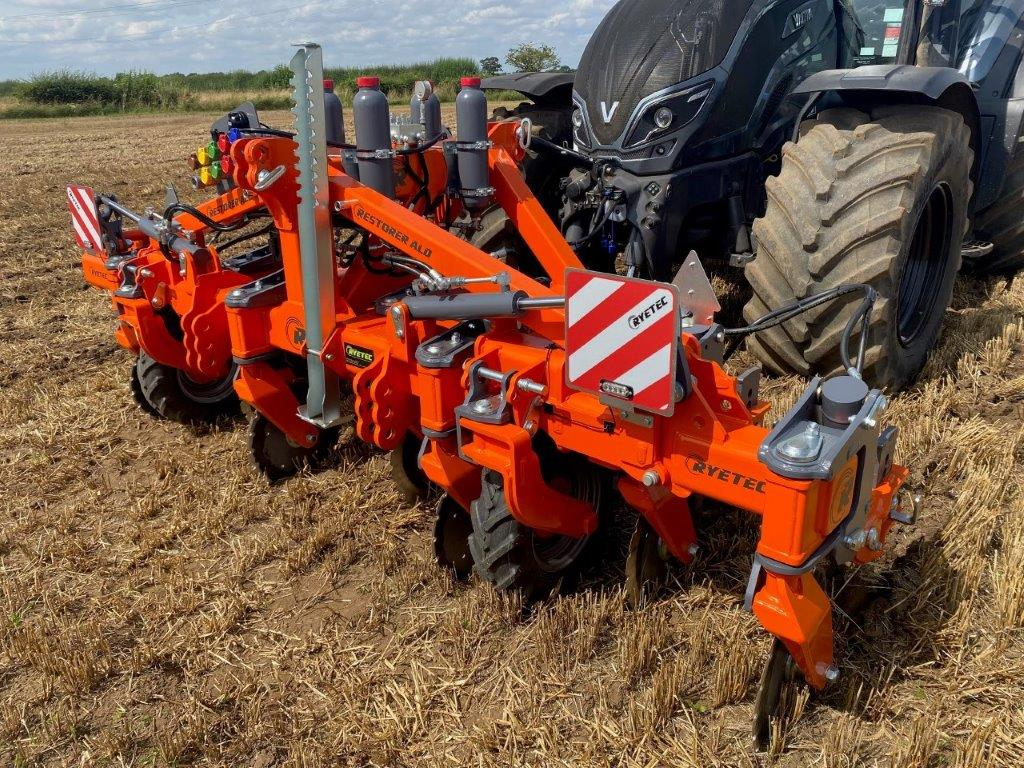 Ryetec ALD Restorer low disturbance sub soiler tool bar front mounted on valtra with direct drill.2